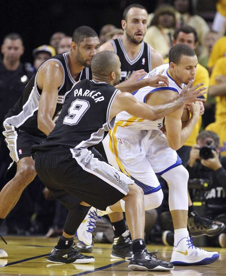 The Spurs' Tony Parker, Tim Duncan and Spurs' Manu Ginobili defend the Warriors' Stephen Curry during overtime action in Game 4 of the Western Conference semifinals Sunday, May 12, 2013 at Oracle Arena in Oakland. The Warriors won 97-87 in overtime.