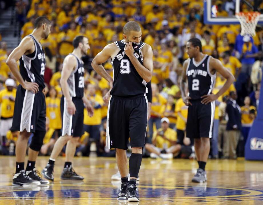 The Spurs' Tim Duncan (from left), Manu Ginobili, Tony Parker and Kawhi Leonard pause during overtime action in Game 4 of the Western Conference semifinals against the Golden State Warriors on Sunday May 12, 2013 at Oracle Arena in Oakland. The Warriors won 97-87 in overtime.