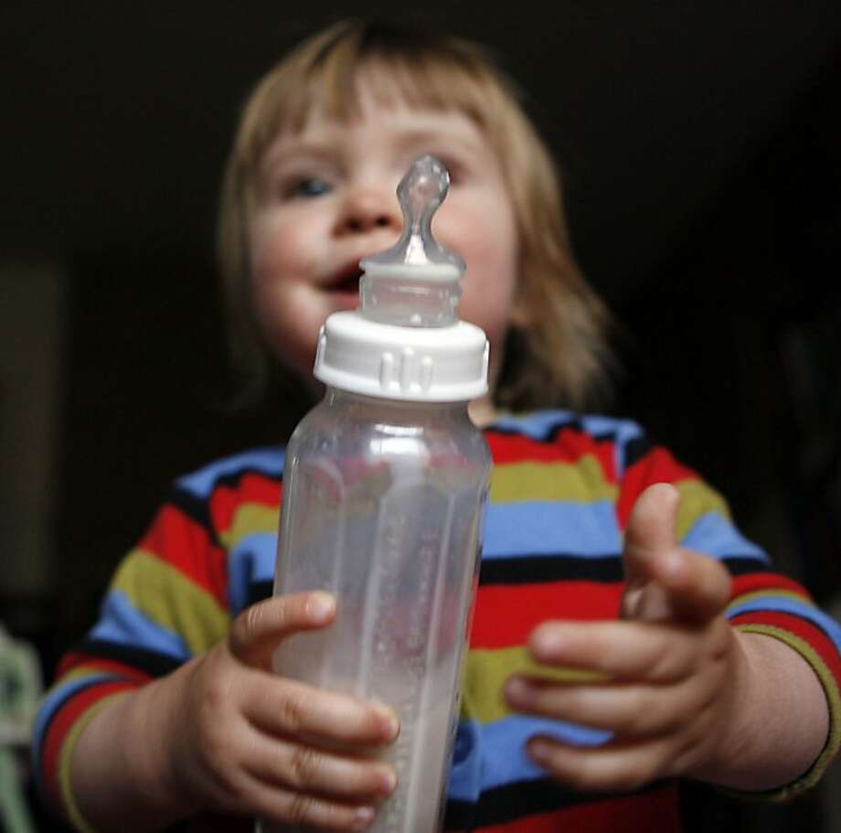 BOTTLES09_19593.JPG  Glass baby bottles, long considered an anachronism, are making such a comeback that parents can't get their hands on them. 16 mo old Lucina Lippman from Berkeley holds a new glass bottle with organic formula. Photo: Lance Iversen, The Chronicle