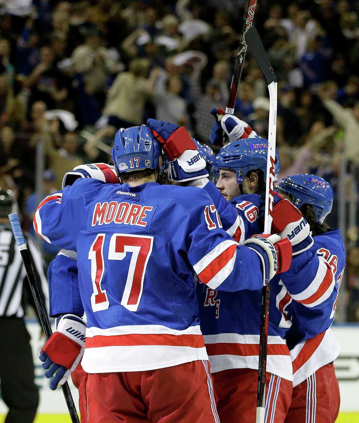 New York Rangers celebrate with teammate Derick Brassard (16) who scored the only goal in the second period of Game 6 of their NHL Stanley Cup hockey playoff series against the Washington Capitals in New York, Sunday, May 12, 2013. The Rangers shut out the Capitals to force a Game 7 in Washington, Monday.