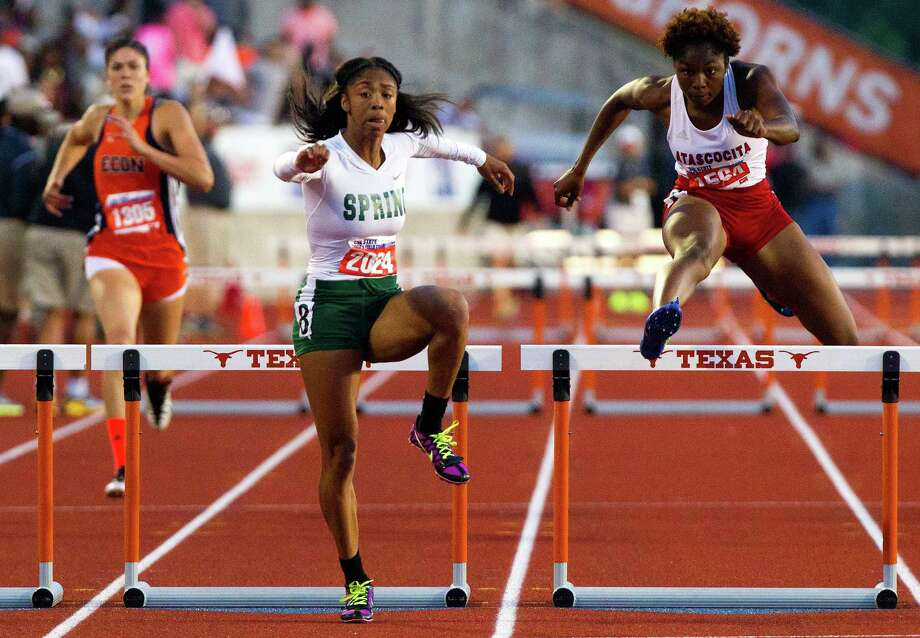 Edinb's Leigha Brown, left, trails Spring's Alaysh'A Johnson, center, and Atascocita's Ariel Jones, right, as they compete in the 5A Girls 300 Meter Hurdles during the UIL High School State Track Meet at Mike A. Myers Stadium Saturday, May 11, 2013, in Austin. (Cody Duty / Houston Chronicle) Photo: Cody Duty, Staff / © 2013 Houston Chronicle