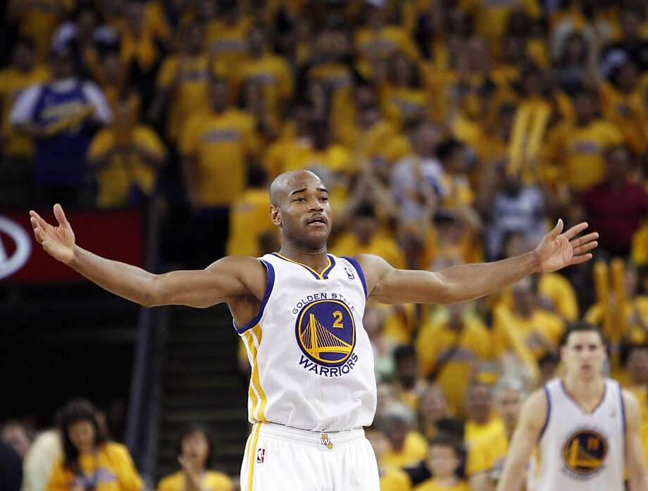 Jarrett Jack (2) tries to get the crowd into the game in the overtime period. The Golden State Warriors played the San Antonio Spurs in Game 4 of the Western Conference Semifinals at Oracle Arena in Oakland, Calif., on Sunday, May 12, 2013. Photo: Carlos Avila Gonzalez, The Chronicle