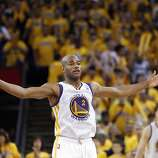 Jarrett Jack (2) tries to get the crowd into the game in the overtime period. The Golden State Warriors played the San Antonio Spurs in Game 4 of the Western Conference Semifinals at Oracle Arena in Oakland, Calif., on Sunday, May 12, 2013.