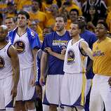 Warriors players watched the final seconds of the overtime period. The Golden State Warriors beat the San Antonio Spurs 97-87 in the playoffs Sunday May 12, 2013 at Oracle Arena in Oakland, Calif.