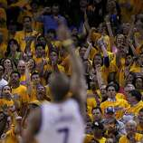 Carl Landry (7) led a cheer as the Warriors took over in the overtime period. The Golden State Warriors beat the San Antonio Spurs 97-87 in the playoffs Sunday May 12, 2013 at Oracle Arena in Oakland, Calif.