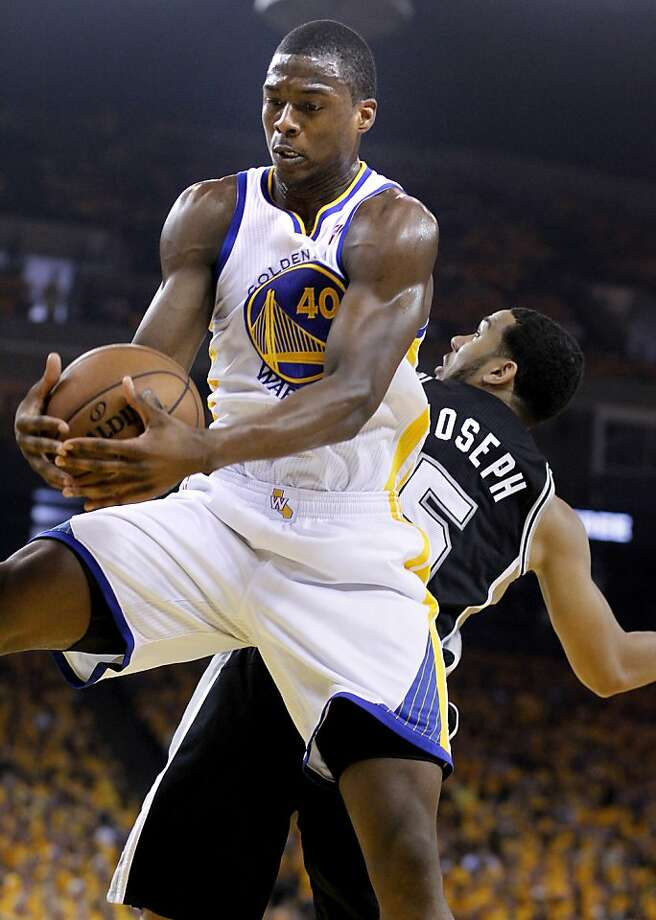 Harrison Barnes (40) came up with a big rebound against Cory Joseph (5) in the first half.The Golden State Warriors beat the San Antonio Spurs 97-87 in the playoffs Sunday May 12, 2013 at Oracle Arena in Oakland, Calif. Photo: Brant Ward, The Chronicle