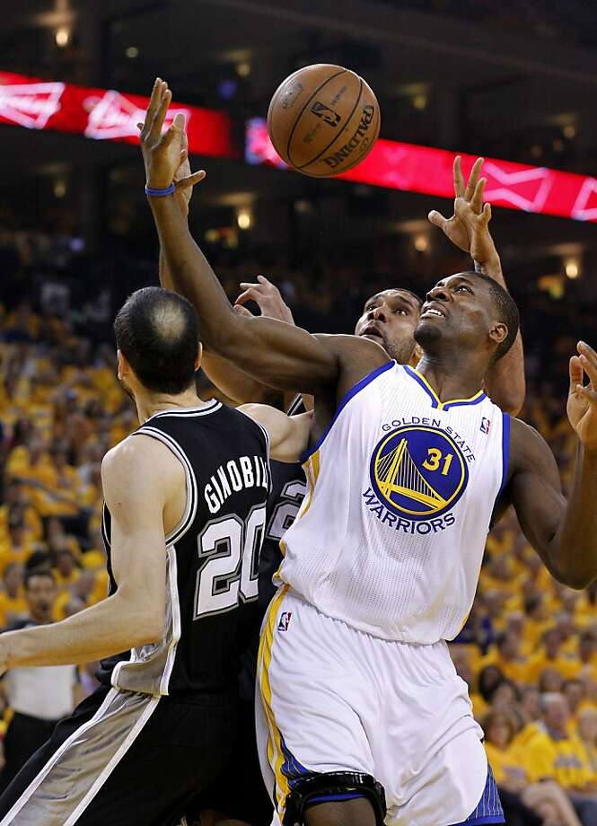 The Warriors Festus Ezeli (31) did battle for a rebound with Manu Ginobli (20) and Tim Duncan. The Golden State Warriors beat the San Antonio Spurs 97-87 in the playoffs Sunday May 12, 2013 at Oracle Arena in Oakland, Calif. Photo: Brant Ward, The Chronicle