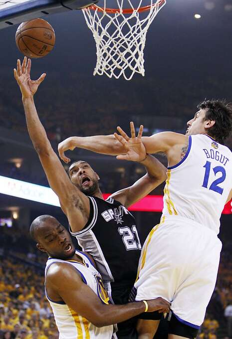 Carl Landry and Andrew Bogut defend against San Antonio's Tim Duncan in the first half. The Warriors held the Spurs' perennial All-Star power forward to 7-for-22 shooting in Game 4. Photo: Carlos Avila Gonzalez, The Chronicle