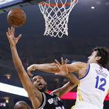 Carl Landry and Andrew Bogut defend against San Antonio's Tim Duncan in the first half. The Warriors held the Spurs' perennial All-Star power forward to 7-for-22 shooting in Game 4.