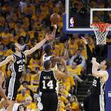 Harrison Barnes (40) scores while defended by three Spurs in the first half. The Golden State Warriors played the San Antonio Spurs in Game 4 of the Wester Conference Semifinals at Oracle Arena in Oakland, Calif., on Sunday, May 12, 2013.