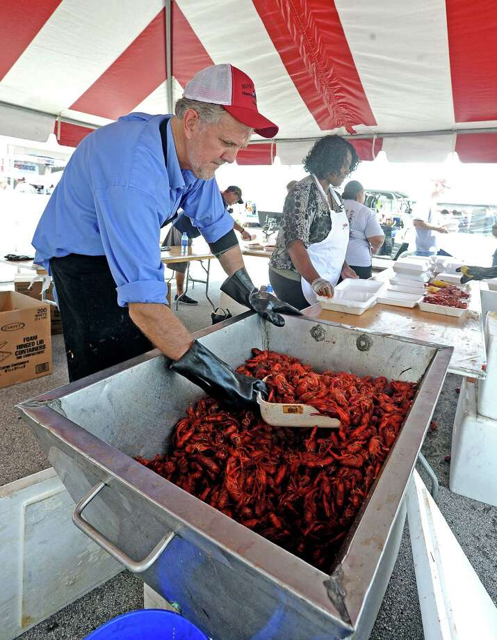 Jim Baxter and the Region 5 crew serve crawfish at the Boys' Haven 28th Annual Crawfish, Food, and Music Festival on Saturday, May 11, 2013, at Parkdale Mall. Photo taken: Randy Edwards/The Enterprise Photo: Randy Edwards