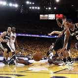 Kawhi Leonard (2) lunges for a loose ball in the second half. The Golden State Warriors played the San Antonio Spurs in Game 4 of the Wester Conference Semifinals at Oracle Arena in Oakland, Calif., on Sunday, May 12, 2013.