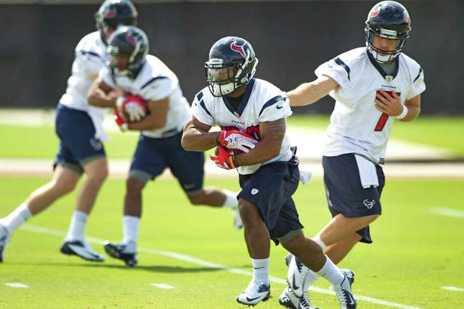 Dennis Johnson, center, is one of the hopefuls trying to make a Texans roster thin on running backs. Photo: Brett Coomer, Staff / © 2013 Houston Chronicle