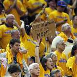 One Warriors fan tries to get the Warriors to win one for mom in the second half. The Golden State Warriors played the San Antonio Spurs in Game 4 of the Wester Conference Semifinals at Oracle Arena in Oakland, Calif., on Sunday, May 12, 2013.