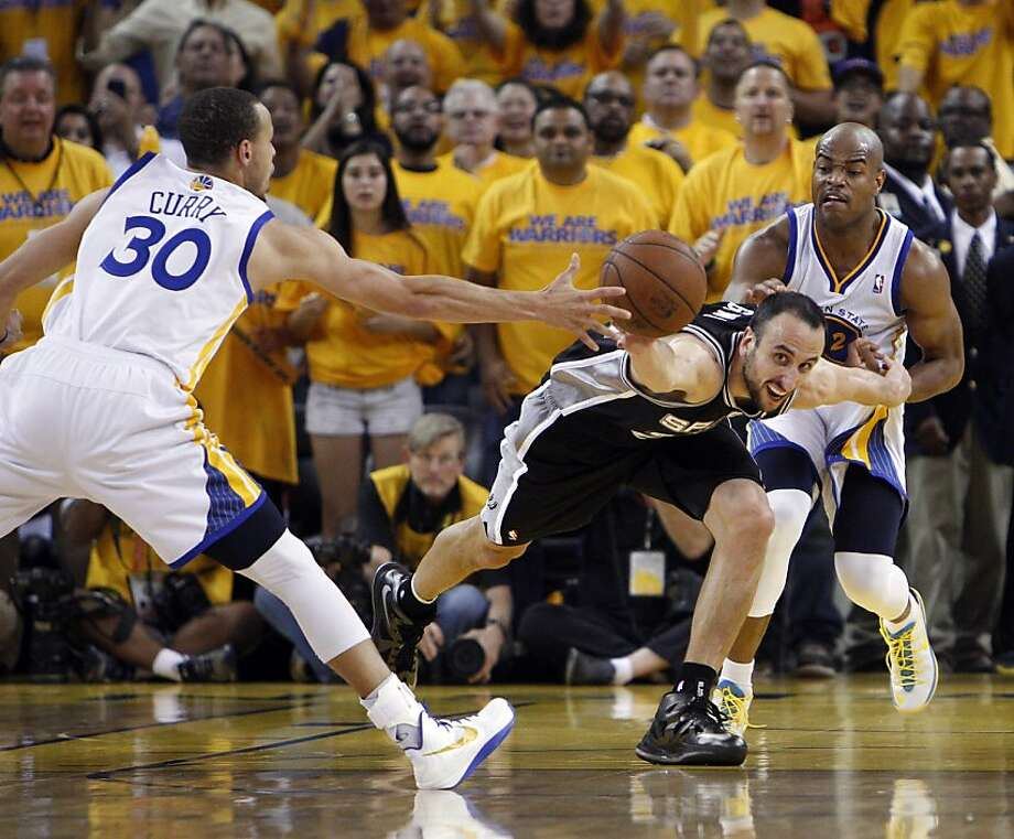 Manu Ginobli (20) and Stephen Curry (30) lunge for a loose ball in the overtime period. The ball went out of bounds and was ruled that Stephen Curry last touched it after a review. The Golden State Warriors played the San Antonio Spurs in Game 4 of the Wester Conference Semifinals at Oracle Arena in Oakland, Calif., on Sunday, May 12, 2013. Photo: Carlos Avila Gonzalez, The Chronicle