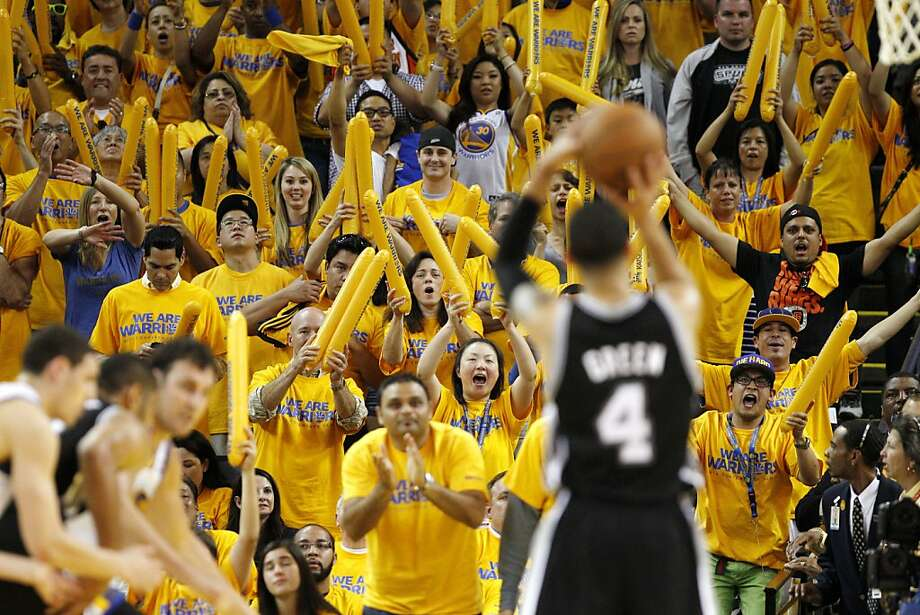 The Warriors fans try their best to distract Danny Green (2) as he shoots a free throw late in the second half. The Golden State Warriors played the San Antonio Spurs in Game 4 of the Wester Conference Semifinals at Oracle Arena in Oakland, Calif., on Sunday, May 12, 2013. Photo: Carlos Avila Gonzalez, The Chronicle