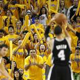 The Warriors fans try their best to distract Danny Green (2) as he shoots a free throw late in the second half. The Golden State Warriors played the San Antonio Spurs in Game 4 of the Wester Conference Semifinals at Oracle Arena in Oakland, Calif., on Sunday, May 12, 2013.