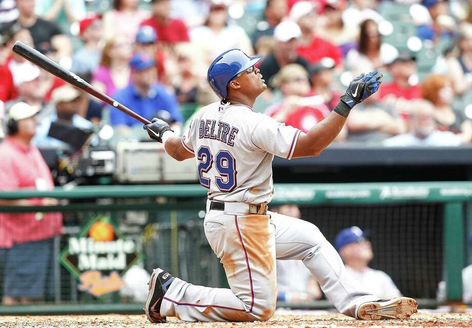 Adrian Beltre watches his three-run home run — initially ruled a double — during the fifth inning that gave Texas a 12-1 lead. Photo: Bob Levey / Getty Images