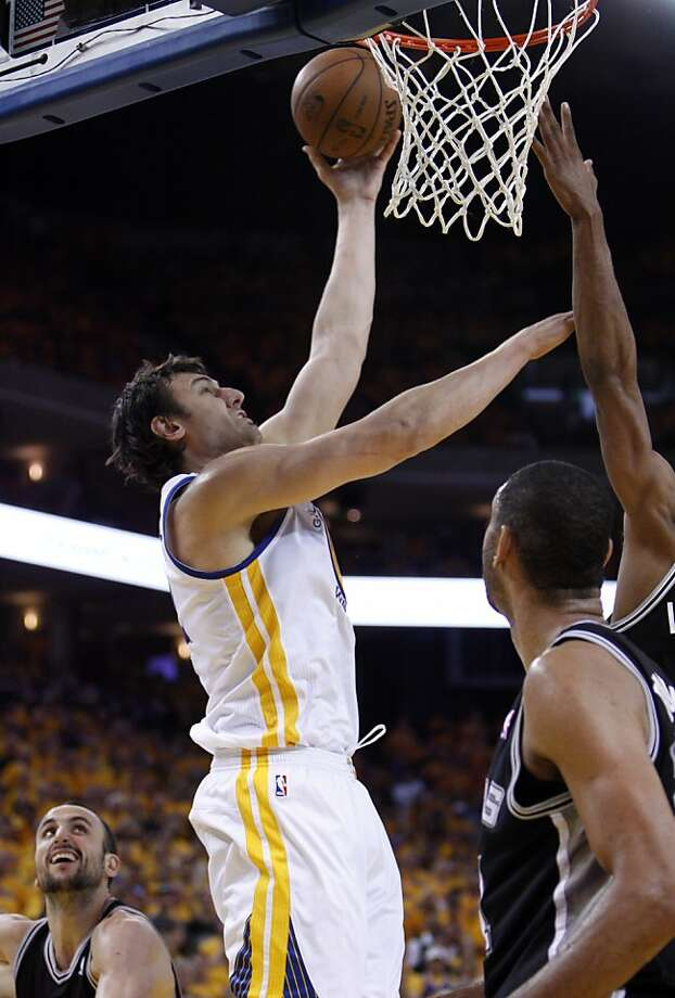 Andrew Bogut (12) puts in a shot in the second half. The Golden State Warriors played the San Antonio Spurs in Game 4 of the Wester Conference Semifinals at Oracle Arena in Oakland, Calif., on Sunday, May 12, 2013. Photo: Carlos Avila Gonzalez, The Chronicle