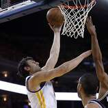 Andrew Bogut (12) puts in a shot in the second half. The Golden State Warriors played the San Antonio Spurs in Game 4 of the Wester Conference Semifinals at Oracle Arena in Oakland, Calif., on Sunday, May 12, 2013.
