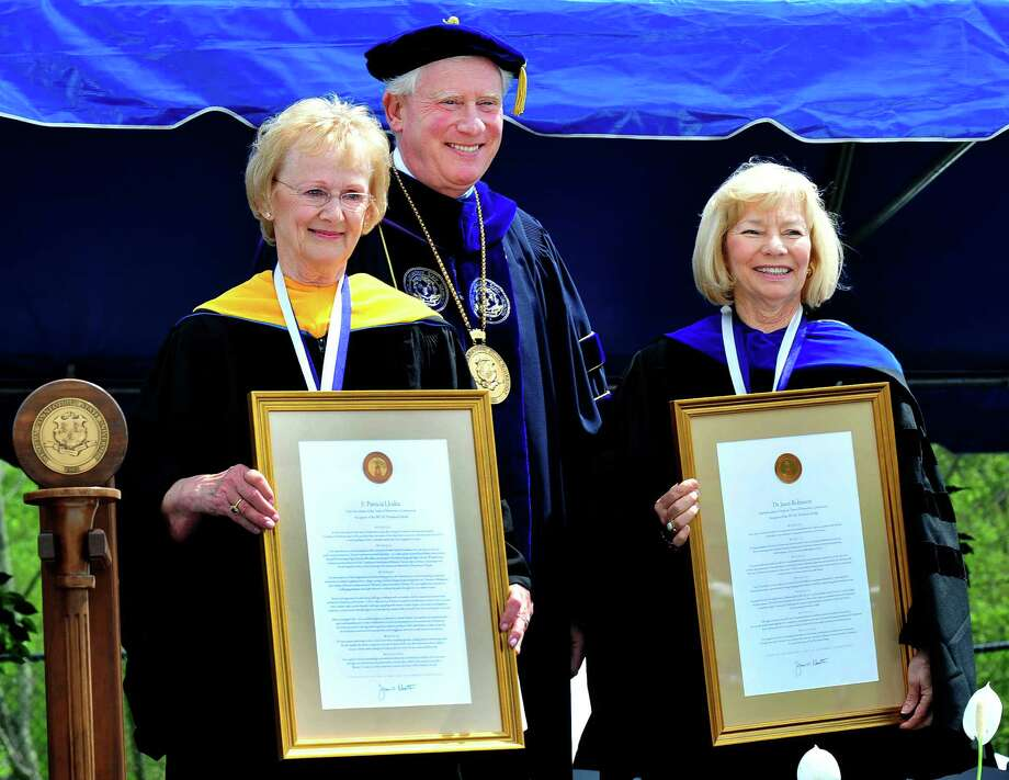 Newtown First Selectman E. Patricia Llodra, left, and former Newtown Superintendent of Schools, Janet Robinson are honored by WCSU President James Schmotter as the class of 2013 graduates during Western Connecticut State University's 115th Commencement Exercises in Danbury, Conn. Sunday, May 12, 2013. Photo: Michael Duffy / The News-Times