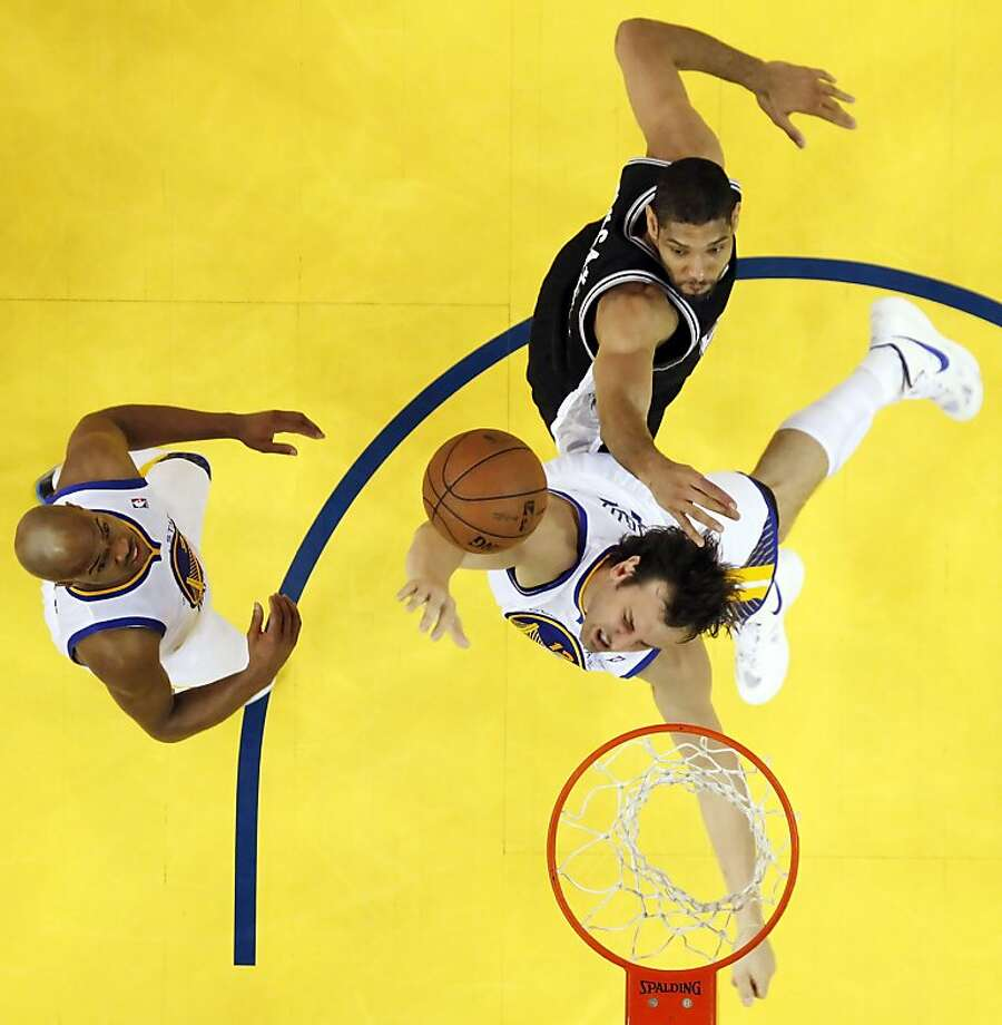 Andrew Bogut gets fouled by Tim Duncan while going for a rebound in the second half. Bogut, a 50 percent free-throw shooter during the season, made one of two foul shots in Game 4. Photo: Carlos Avila Gonzalez, The Chronicle