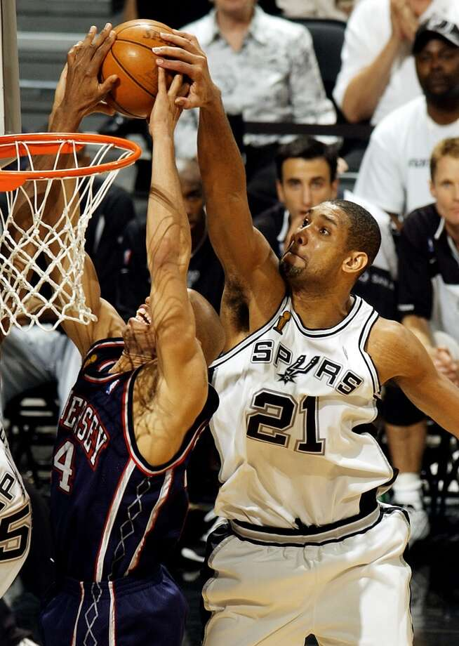 2003 NBA Finals vs. New Jersey Nets: The Spurs win Game 5 (93-83) and Game 6 (88-77) to take series 4-2 and ...PHOTO: The Spurs' Tim Duncan blocks the Nets' Richard Jefferson during the second quarter of Game 6 of the NBA Finals at the SBC Center on June 15, 2003. Photo: William Luther, San Antonio Express-News