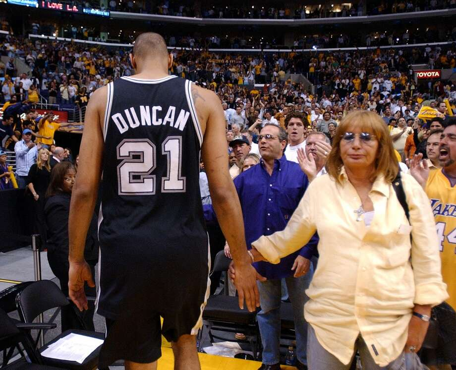 2004 Western Conference Semifinals vs. Los Angeles Lakers: The Spurs drop Games 5 (74-73) and 6 (88-76) to lose series 4-2, ending their season.PHOTO: The Spurs' Tim Duncan shakes hands with Penny Marshall as he walks off the court after losing Game 6 and the Western Conference semifinals to the Lakers in Los Angeles on May 15, 2004. Photo: Edward A. Ornelas, San Antonio Express-News