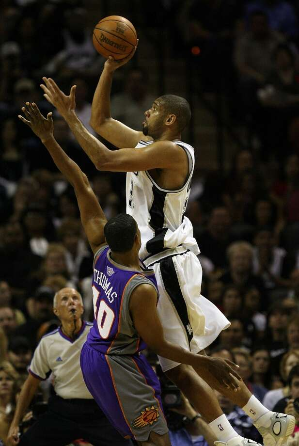 2007 Western Conference Semifinals vs. Phoenix Suns: The Spurs get back-to-back wins in Games 5 (88-85) and 6 (114-106) to take series 4-2. In the Western Conference finals, the Spurs top the Utah Jazz 4-1 ... PHOTO: The Spurs' Tim Duncan shoots over the Suns' Kurt Thomas during the first half of Game 6 of the Western Conference semifinals at the AT&T Center on May 18, 2007. Photo: Edward A. Ornelas, San Antonio Express-News