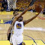 Tim Duncan (21) fouls Jarrett Jack (2) in the first half. The Golden State Warriors played the San Antonio Spurs in Game 4 of the Wester Conference Semifinals at Oracle Arena in Oakland, Calif., on Sunday, May 12, 2013.