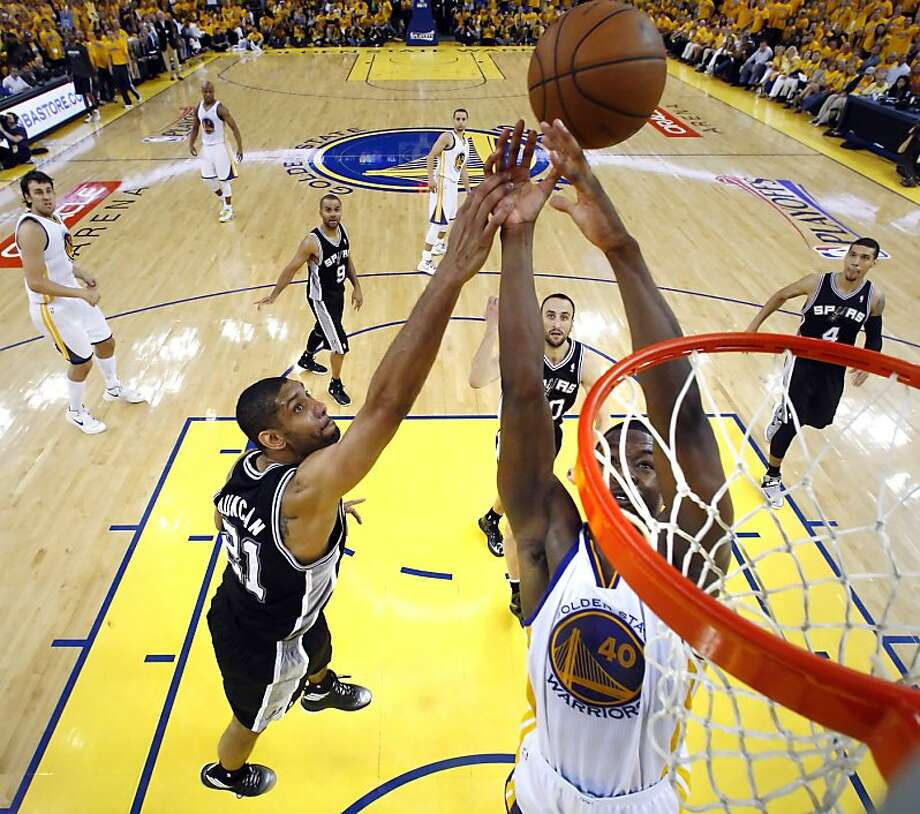 Harrison Barnes (40) tries to get a rebound on a three point shot attempt by Stephen Curry in the second half. The Golden State Warriors played the San Antonio Spurs in Game 4 of the Wester Conference Semifinals at Oracle Arena in Oakland, Calif., on Sunday, May 12, 2013. Photo: Carlos Avila Gonzalez, The Chronicle