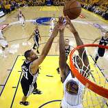 Harrison Barnes (40) tries to get a rebound on a three point shot attempt by Stephen Curry in the second half. The Golden State Warriors played the San Antonio Spurs in Game 4 of the Wester Conference Semifinals at Oracle Arena in Oakland, Calif., on Sunday, May 12, 2013.
