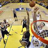 Harrison Barnes (40) and David Lee (10) try to get a rebound in the second half. The Golden State Warriors played the San Antonio Spurs in Game 4 of the Wester Conference Semifinals at Oracle Arena in Oakland, Calif., on Sunday, May 12, 2013.