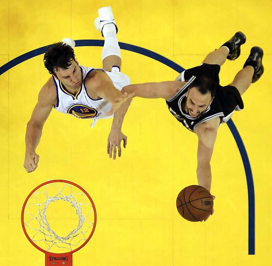 Andrew Bogut (12) defends against Manu Ginobli (20) in the overtime period. The Golden State Warriors played the San Antonio Spurs in Game 4 of the Wester Conference Semifinals at Oracle Arena in Oakland, Calif., on Sunday, May 12, 2013. Photo: Carlos Avila Gonzalez, The Chronicle