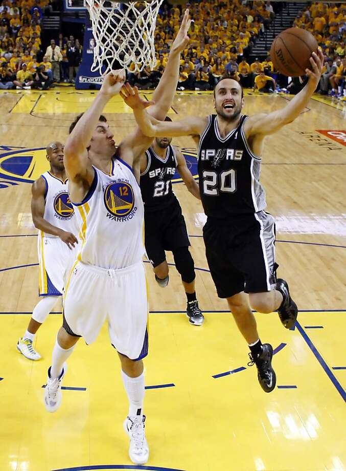 Andrew Bogut (12) defends against a shot by Manu Ginobli (20) in the second half. The Golden State Warriors played the San Antonio Spurs in Game 4 of the Wester Conference Semifinals at Oracle Arena in Oakland, Calif., on Sunday, May 12, 2013. Photo: Carlos Avila Gonzalez, The Chronicle