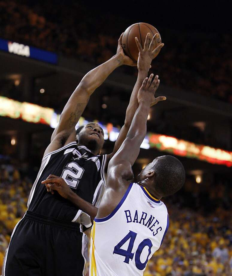 Kawhi Leonard (2) tries to put a shot in over Harrison Barnes (40) in the first half. The Golden State Warriors played the San Antonio Spurs in Game 4 of the Wester Conference Semifinals at Oracle Arena in Oakland, Calif., on Sunday, May 12, 2013. Photo: Carlos Avila Gonzalez, The Chronicle