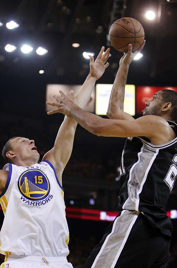 Andris Biedrins (15) tries to defend against a shot by Tim Duncan (21) in the first half. The Golden State Warriors played the San Antonio Spurs in Game 4 of the Wester Conference Semifinals at Oracle Arena in Oakland, Calif., on Sunday, May 12, 2013. Photo: Carlos Avila Gonzalez, The Chronicle