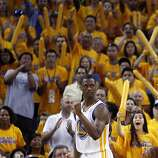 Harrison Barnes (40) pumps his fist after the Spurs were called for a foul on a rebound in the overtime period. The Golden State Warriors played the San Antonio Spurs in Game 4 of the Wester Conference Semifinals at Oracle Arena in Oakland, Calif., on Sunday, May 12, 2013.