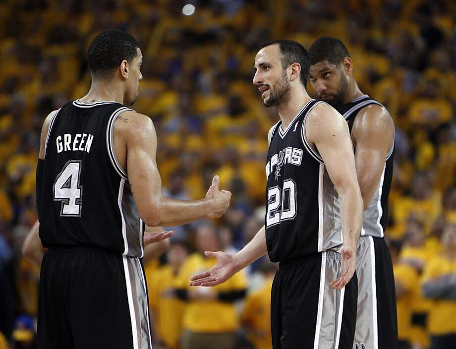 Manu Ginobli (20) communicates with teammates in the overtime period. The Golden State Warriors played the San Antonio Spurs in Game 4 of the Wester Conference Semifinals at Oracle Arena in Oakland, Calif., on Sunday, May 12, 2013. Photo: Carlos Avila Gonzalez, The Chronicle