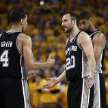Manu Ginobli (20) communicates with teammates in the overtime period. The Golden State Warriors played the San Antonio Spurs in Game 4 of the Wester Conference Semifinals at Oracle Arena in Oakland, Calif., on Sunday, May 12, 2013.