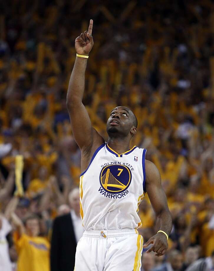 Carl Landry (7) reacts to hitting a shot in the overtime period. The Golden State Warriors played the San Antonio Spurs in Game 4 of the Wester Conference Semifinals at Oracle Arena in Oakland, Calif., on Sunday, May 12, 2013. Photo: Carlos Avila Gonzalez, The Chronicle