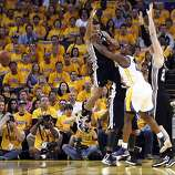 Harrison Barnes (40) pushes off Gary Neal (14) after Neal collides with Barnes in the first half. The Golden State Warriors played the San Antonio Spurs in Game 4 of the Wester Conference Semifinals at Oracle Arena in Oakland, Calif., on Sunday, May 12, 2013.