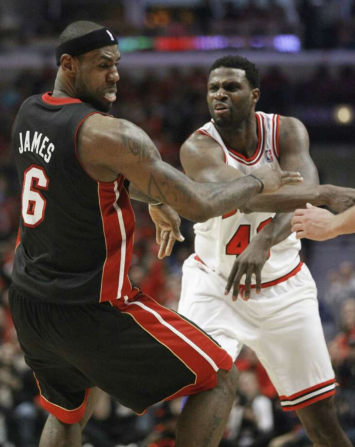 Bulls coach Tom Thibodeau accused Miami's LeBron James of flopping when shoved by Chicago's Nazr Mohammed (right) during Game 3. Mohammed was ejected after the play. Photo: Charles Rex Arbogast / Associated Press