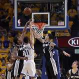 Klay Thompson (11) scores past three defenders in the first half. The Golden State Warriors played the San Antonio Spurs in Game 4 of the Wester Conference Semifinals at Oracle Arena in Oakland, Calif., on Sunday, May 12, 2013.