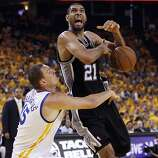 Tim Duncan (21) is fouled by Andris Biedrins (15) in the first half. The Golden State Warriors played the San Antonio Spurs in Game 4 of the Wester Conference Semifinals at Oracle Arena in Oakland, Calif., on Sunday, May 12, 2013.