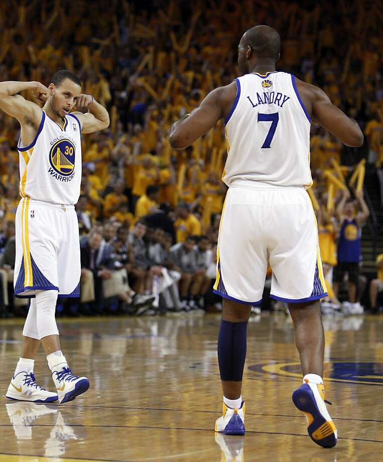 Stephen Curry (30) and Carl Landry (7) celebrate a basket made by Landry in the second half. The Golden State Warriors played the San Antonio Spurs in Game 4 of the Wester Conference Semifinals at Oracle Arena in Oakland, Calif., on Sunday, May 12, 2013. Photo: Carlos Avila Gonzalez, The Chronicle
