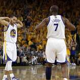 Stephen Curry (30) and Carl Landry (7) celebrate a basket made by Landry in the second half. The Golden State Warriors played the San Antonio Spurs in Game 4 of the Wester Conference Semifinals at Oracle Arena in Oakland, Calif., on Sunday, May 12, 2013.