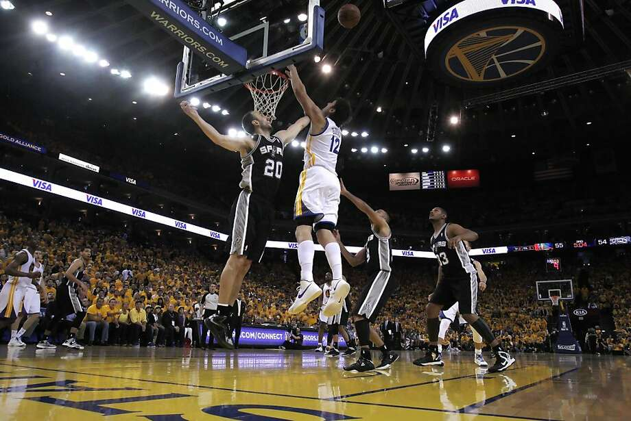 Manu Ginobli (20) and Andrew Bogut (12) go up for a rebound in the second half. The Golden State Warriors played the San Antonio Spurs in Game 4 of the Wester Conference Semifinals at Oracle Arena in Oakland, Calif., on Sunday, May 12, 2013. Photo: Carlos Avila Gonzalez, The Chronicle
