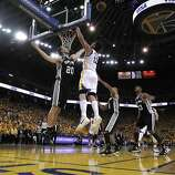 Manu Ginobli (20) and Andrew Bogut (12) go up for a rebound in the second half. The Golden State Warriors played the San Antonio Spurs in Game 4 of the Wester Conference Semifinals at Oracle Arena in Oakland, Calif., on Sunday, May 12, 2013.