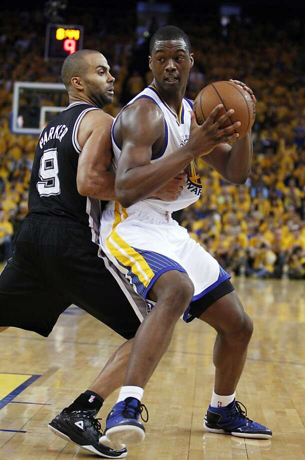 Harrison Barnes (40) drives the ball defended by Tony Parker (9) in the second half. The Golden State Warriors played the San Antonio Spurs in Game 4 of the Wester Conference Semifinals at Oracle Arena in Oakland, Calif., on Sunday, May 12, 2013. Photo: Carlos Avila Gonzalez, The Chronicle